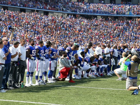 Some Bills players take a knee during the national