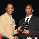 Johnathan Williams receives the U.S. Marine Corps Excellence in Leadership Award from Maj. Gen. Craig C. Crenshaw.