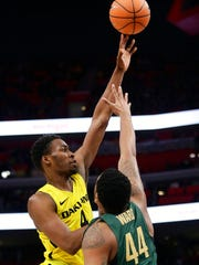 Oakland forward Jalen Hayes (4) takes a shot against Michigan State forward Nick Ward (44) during the first half of an NCAA college basketball game Saturday, Dec. 16, 2017, in Detroit.