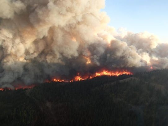 The Strawberry Fire on the ridge to Cap Mountain in
