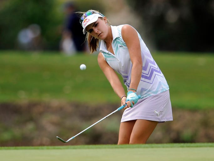Lexi Thompson hits out of a bunker on the fifth hole in the second round of the Kraft Nabisco Championship golf tournament at Mission Hills Country Club in April. Thompson won the event for her first major title.