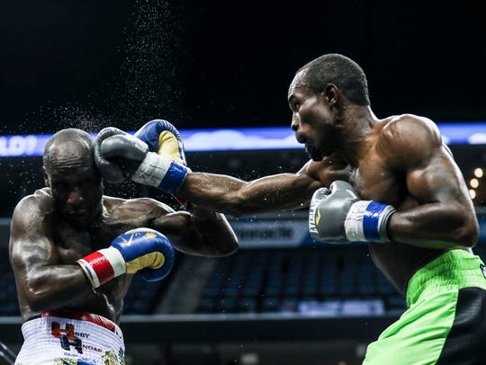 """'Vicious' Vivian Harris, right, connects with DeMarcus 'Chop Chop' Corley during the American Boxing Federation's """"The Big Payback"""" on Saturday night at FedExForum."""