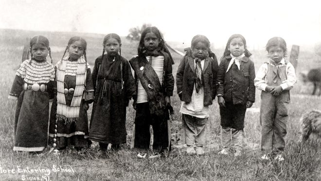 Small Sioux children before they entered a boarding school in 1897. Library of Congress.