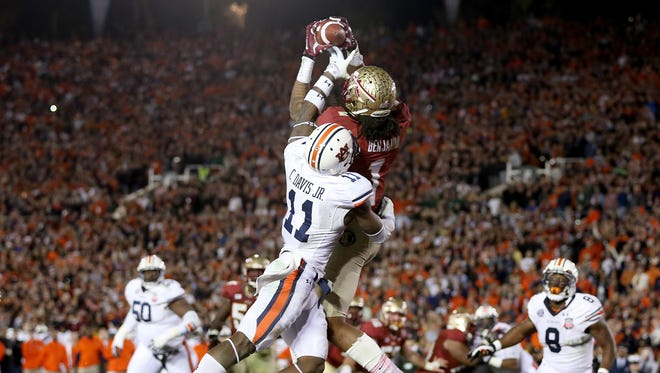 The image of Kelvin Benjamin catching the game-winning touchdown pass has become an iconic symbol of FSUâ??s third national title.  Glenn Beil/ Democrat as Florida State defeats Auburn 34-31 to take the BCS National Championship game on Monday Jan., 6, 2014. The Florida State Seminoles used late game heroics to take down the Auburn Tigers at the Rose Bowl in Pasadena, CA.