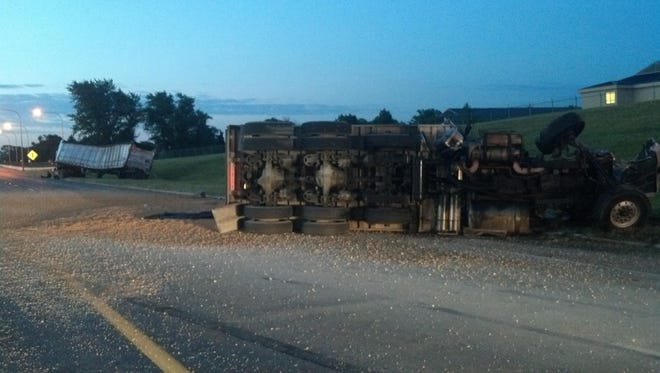 A fully loaded dump truck overturned, spilling its load of stone onto Del. 1 when it ran into the back of a tractor-trailer early Thursday morning, state police said.