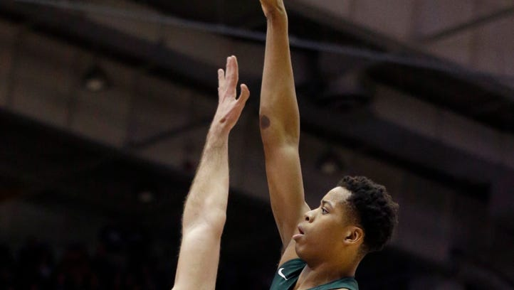Michigan State freshman Deyonta Davis celebrates during MSU's win over Northwestern Thursday. Davis finished with eight points, 11 rebounds and six blocks in the 31-point victory.