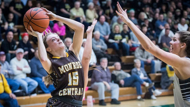 Monroe Central's Hannah Bolton shoots past Madison-Grant's defense during their game at Eastern High School in Greentown Saturday, Feb. 11, 2017.