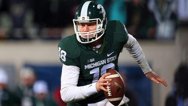 Mike Carter/USA TODAY MSU quarterback Connor Cook returns for the Spartans for his senior season. Mike Carter/USA TODAY Sports Quarterback Connor Cook will guide Michigan State into its first Cotton Bowl appearance. Oct 4, 2014; East Lansing, MI, USA;Michigan State Spartans quarterback Connor Cook (18) scrambles from the pocket against the Nebraska Cornhuskers during the 1st quarter of a game at Spartan Stadium. Mandatory Credit: Mike Carter-USA TODAY Sports