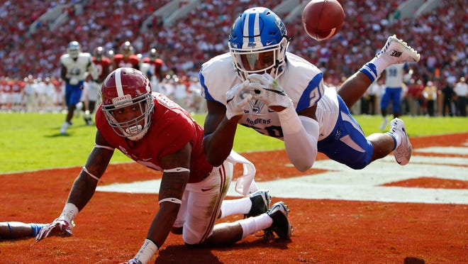 MTSU's Kevin Byard lunges to break up a pass intended for Alabama's ArDarius Stewart during Saturday's game at Bryant-Denny Stadium in Tuscaloosa.
