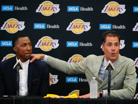 Lakers general manager Rob Pelinka, right, introduces