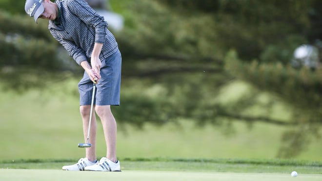 Rice's Harrison Thayer rolls a putt on the 18th hole during Wednesday's high school boys golf state championships at Ralph Myhre Golf Course.Thayer was the Division II medalist with an 82.