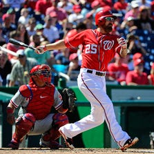 Sep 7, 2014; Washington, DC, USA; Washington Nationals first baseman Adam LaRoche (25) hits a solo home run against the Philadelphia Phillies during the fourth inning at Nationals Park. Mandatory Credit: Brad Mills-USA TODAY Sports