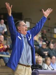 St. Peter's head coach Joe Jakubick calls out a play