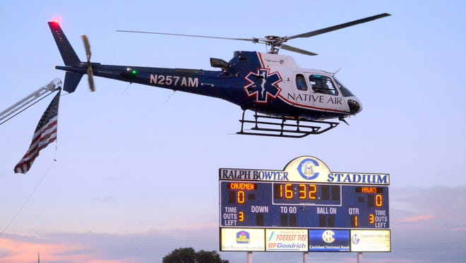 The game ball is delivered by helicopter before the Carlsbad-Centennial football game on Sept. 30, 2016.