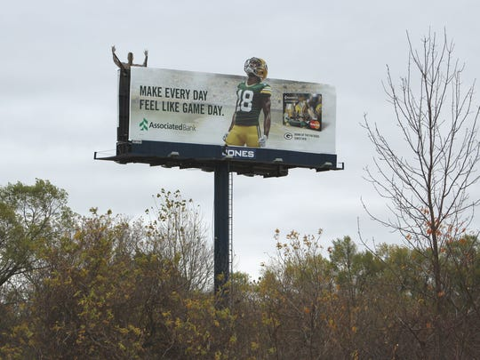 A fog device on this billboard along State 172 in Bellevue prompted some concerned drivers to call 911 thinking the sign was on fire.