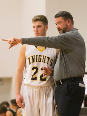 Jon Reichard, right, will not return as the Eastern York head boys' varsity basketball coach. Reichard said the school chose not to rehire him. YORK DISPATCH FILE PHOTO