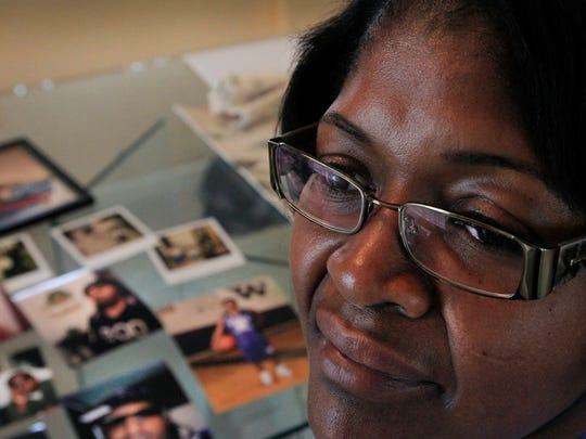 Debra Watson, Indianapolis, mother of Thomas Keys, the young man killed in a recording studio in November 2012, speaks about her son, his death and the trials of his convicted killers in her home on Split Rock Way on the Far Westside on Tuesday, June 3, 2014. On Wednesday, the final two men convicted in the murder of the local DJ will be sentenced.