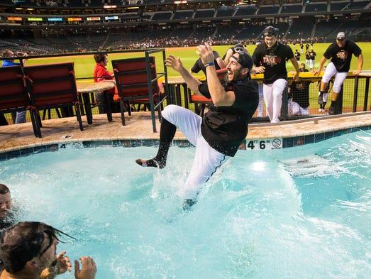Arizona Diamondbacks shortstop Adam Rosales (9) jumps