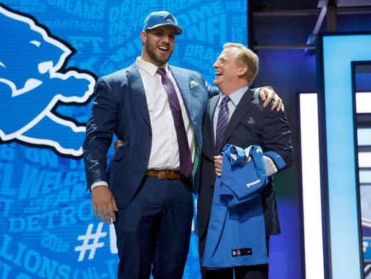 Ohio State's Taylor Decker poses for photos with NFL commissioner Roger Goodell after being selected by the Detroit Lions as the 16th pick in the first round of the 2016 NFL football draft, Thursday, April 28, 2016, in Chicago. (AP Photo/Charles Rex Arbogast)