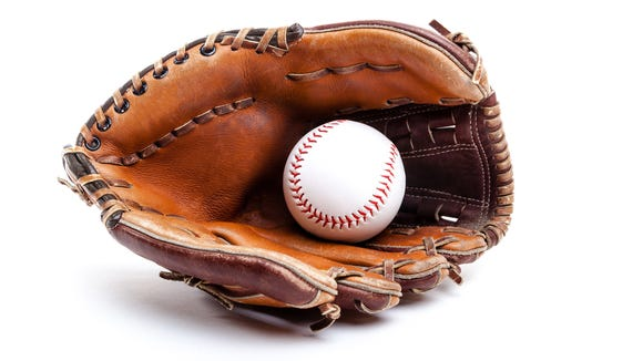 Seasoned leather baseball glove with ball