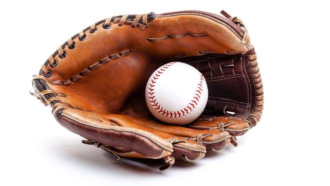 Seasoned leather baseball glove with ball