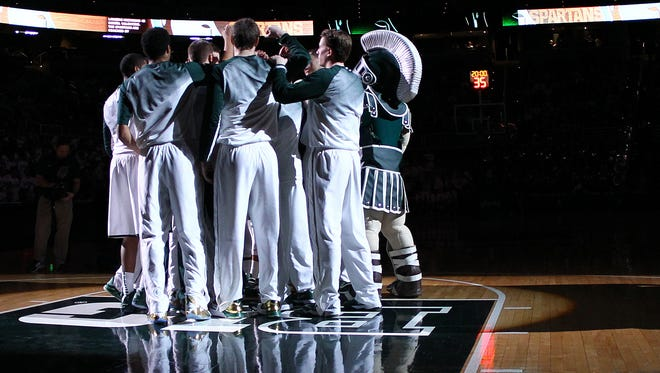 Michigan State Spartans huddle prior to the start of  a game between the Michigan State Spartans and the Northwestern Wildcats at Jack Breslin Student Events Center.