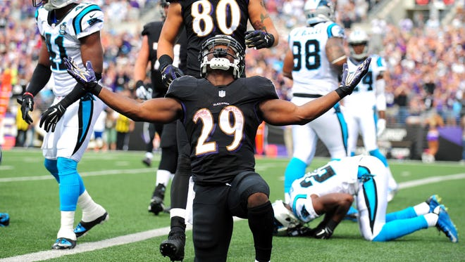 Sep 28, 2014: Baltimore Ravens running back Justin Forsett (29) celebrates after scoring a touchdown in the second quarter against the Carolina Panthers at M&T Bank Stadium.