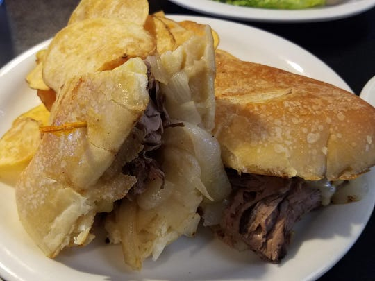 The roast beef in this panini is juicy, flavorful and plentiful. Housemade chips accompany the sandwich.