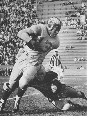Kenny Washington, the first black NFL football player, was signed to the Los Angeles Rams in 1946.