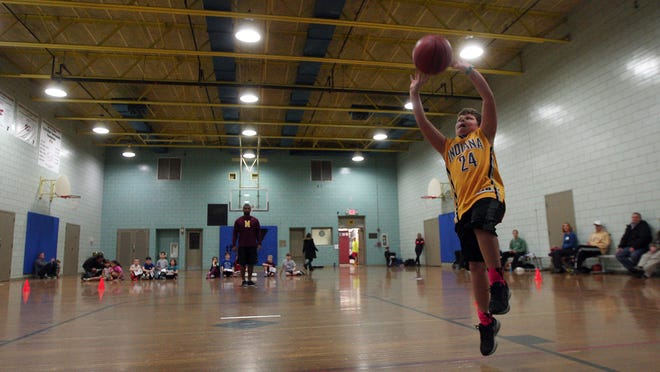 8-year-old Mark Donoghue of Chatham goes for a layup during the Madison Area YMCA-hosted NBA FiT Dribble, Dish & Swish.