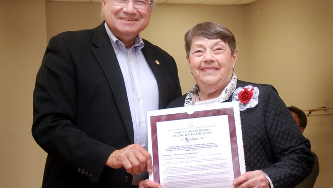 Union County Freeholder Angel G. Estrada presents Evelyn Burnett Marchione with a resolution congratulating her on being named Linden's 2017 Outstanding Senior Citizen of the Year by the Linden Department of Public Property and Community Services during the city's 59th annual Senior Citizen Day ceremony at the John T. Gregorio Recreation Center in Linden.