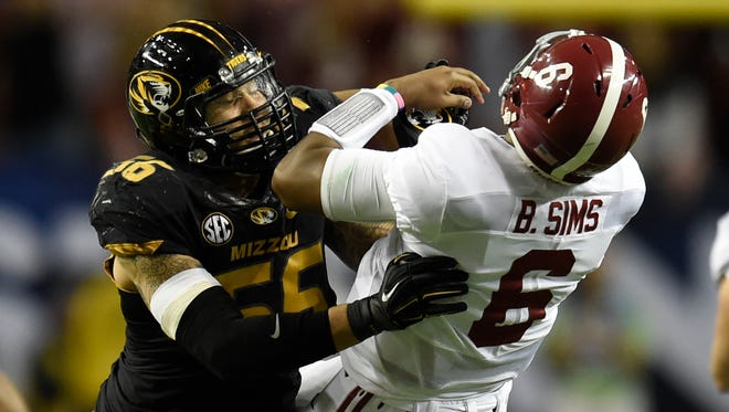 Missouri Tigers defensive lineman Shane Ray (56) tackles Alabama Crimson Tide quarterback Blake Sims (6) during the second quarter of the 2014 SEC Championship Game at the Georgia Dome. The play caused Ray to be ejected from the game for targeting.