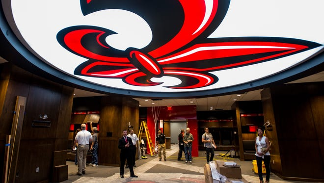 The ceiling and carpet in the center of the Ragin' Cajuns' football locker room, shown here before its 2015 opening, are emblazoned with the UL fleur-de-lis logo. It was here that Cajun players filmed a profane anti-Donald Trump video earlier this month.