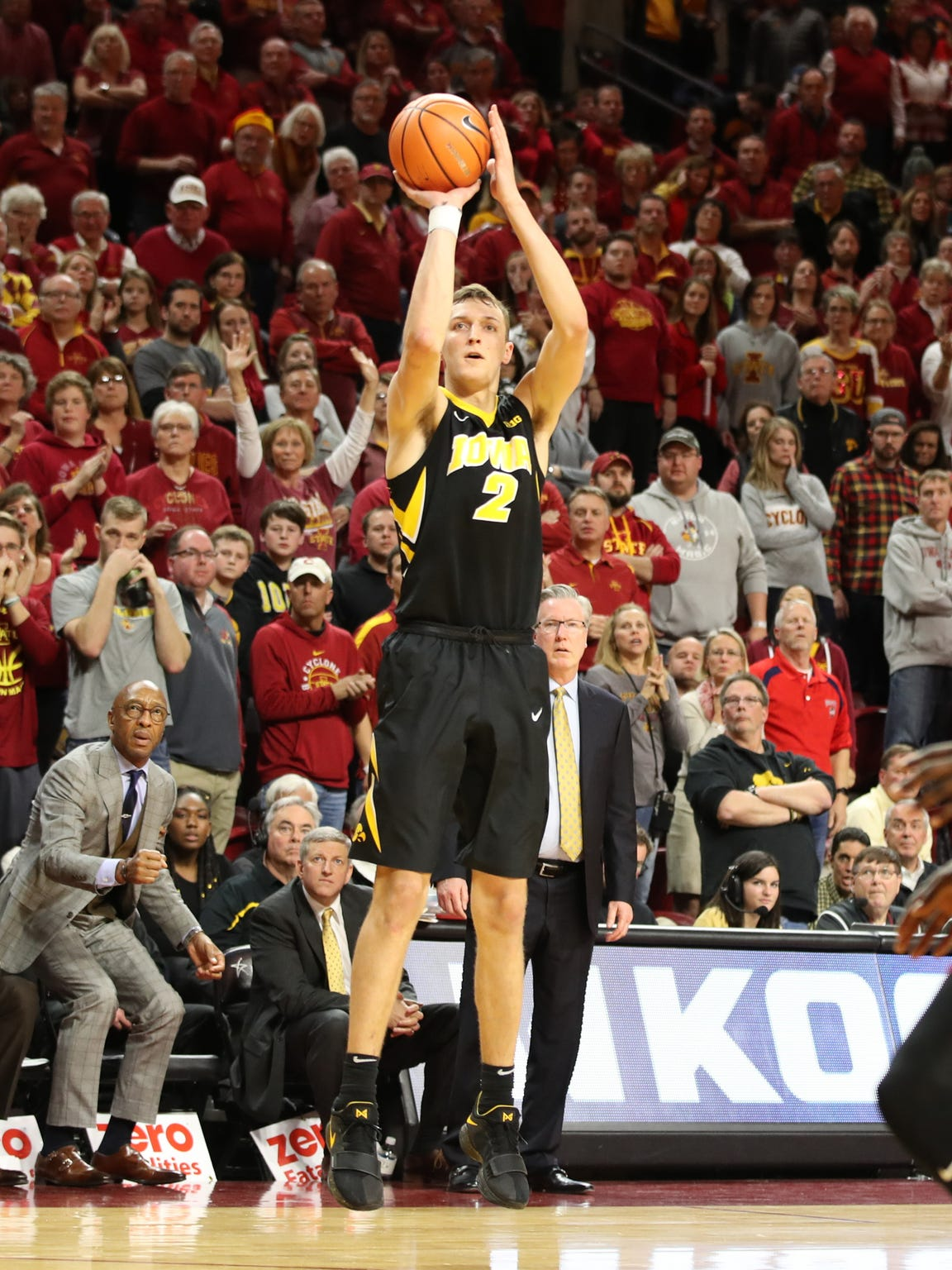 Jack Nunge (2) shoots a three pointer against the Iowa