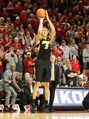 Jack Nunge (2) shoots a three pointer against the Iowa State Cyclones at James H. Hilton Coliseum. The Cyclones beat the Hawkeyes 84 to 78.
