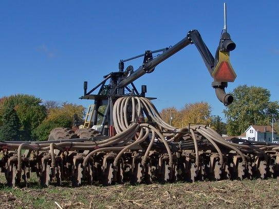 A liquid manure application unit made by Puck Custom