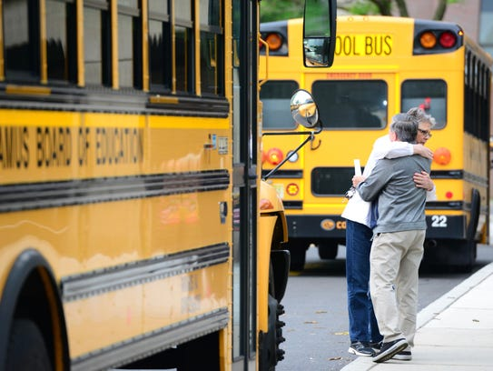Paramus bus drivers hugging at the board of education