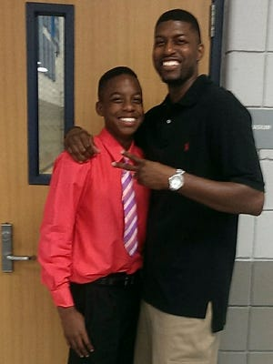 This undated family photo provided by Edwards family attorney Lee Merritt shows Jordan Edwards, left, posing for a photo with his father, Odell Edwards. The family of the black teenager shot and killed by a white police officer while riding in a vehicle leaving a party wants criminal charges filed against the officer, who was fired for violating department policies during the shooting. Balch Springs police Officer Roy Oliver was fired three days after 15-year-old Jordan Edwards' death. (Courtesy of Lee Merritt/Edwards family via AP)