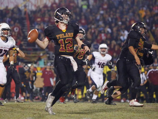 Tulare Union quarterback Nathan Lamb looks to past