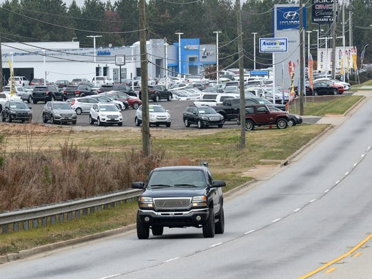 A truck drives by land sold to the left of the Hyundai of Anderson dealership on State Highway 28 bypass in Anderson.