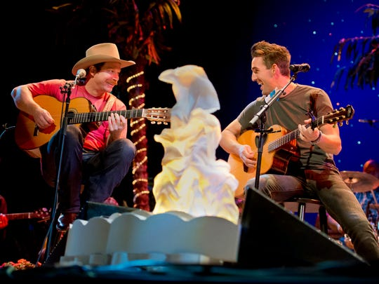 Country music artists and Vero Beach natives Scotty Emerick (left) and Jake Owen share a laugh in December during the first of two concerts Owen is held at Riverside Theatre.