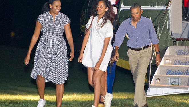 President Obama, first lady Michelle Obama and daughters Malia and Sasha disembark from Marine One on the South Lawn of the White House on Aug. 21, 2016. The Obamas were returning from a vacation in Martha's Vineyard.