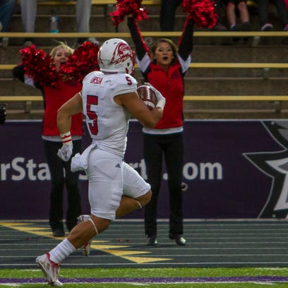 SUU's Naia Ursua returns a punt for a touchdown in the first quarter against Weber State, Friday, Oct. 2, 2015.