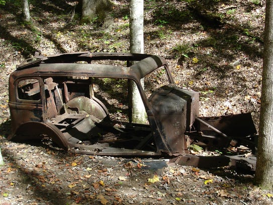 This abandoned and stripped auto is one of several