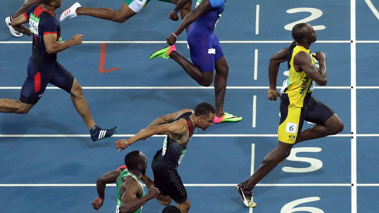 5d434b02ecf Usain Bolt streaks to third consecutive Olympic gold in 100 meters