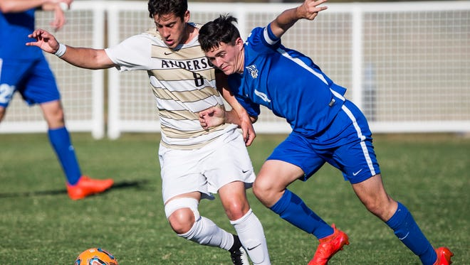 Anderson University senior midfielder Brad Du Plooy and Mars Hill's Cam Macer fight for possession of the ball during the AU doubleheader against Mars Hill on Saturday, October 29, 2016 in Anderson.