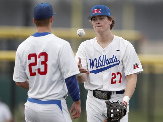Kokomo Wildkats baseball player Bayden Root (27) tosses