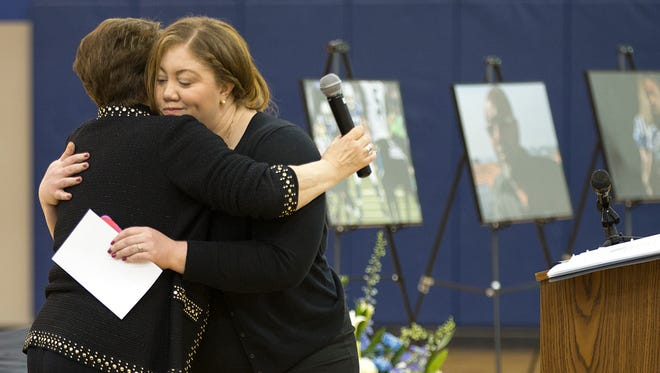 Cora Asiana, sister of late Indianapolis Colt Edwin Jackson, hugs Colleen Sheehey-Church, national president of Mothers Against Drunk Driving, after Asiana spoke during a vigil remembering Jackson and Uber driver Jeffrey Monroe at Guion Creek Middle School in Indianapolis, Thursday, Feb. 15, 2018. Jackson and Monroe were both killed by a suspected drunk driver on Feb. 4, 2018, while standing near their car parked on I-70 in Indianapolis. Mothers Against Drunk Driving, Uber and the Indianapolis Colts hosted the vigil.