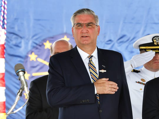 Indiana Governor Eric J. Holcomb. The USS Indiana