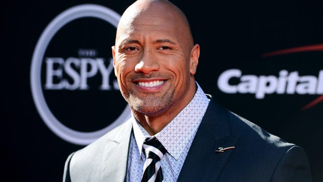 Actor Dwayne Johnson arrives at the ESPY Awards at Nokia Theatre on Wednesday, July 16, 2014, in Los Angeles.